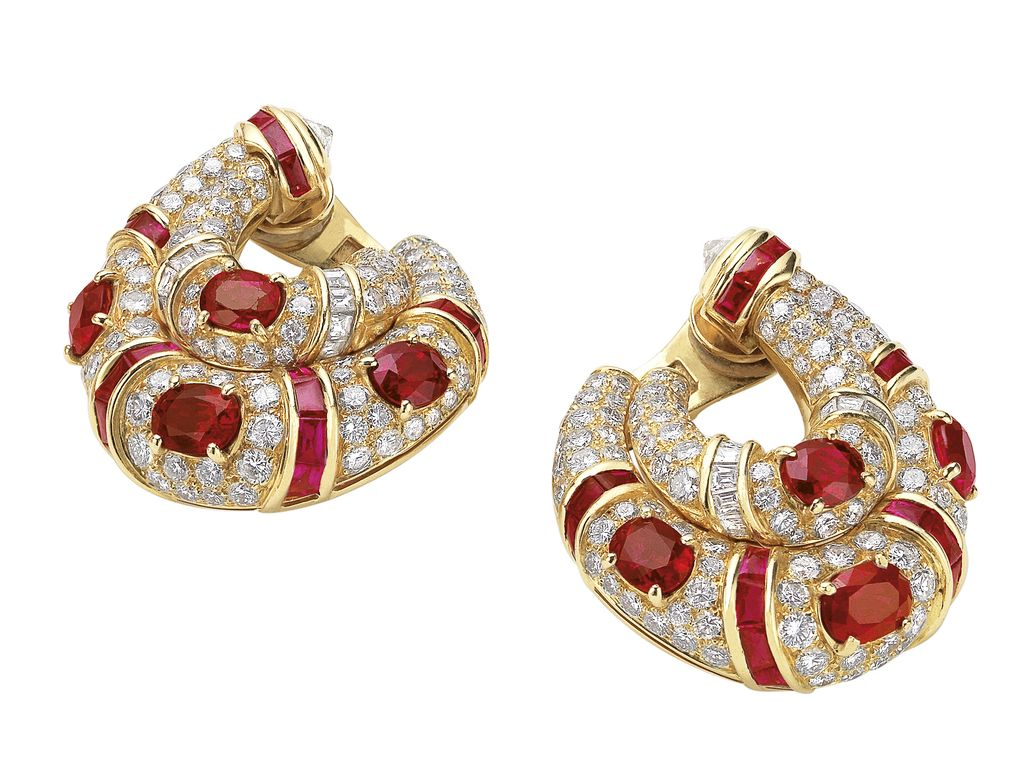 Earrings in gold with rubies and diamonds, 1994. Each of double Creole design, decorated with cushion-shaped and calibrated cut rubies, in a surround of baguette and brilliant-cut diamonds.