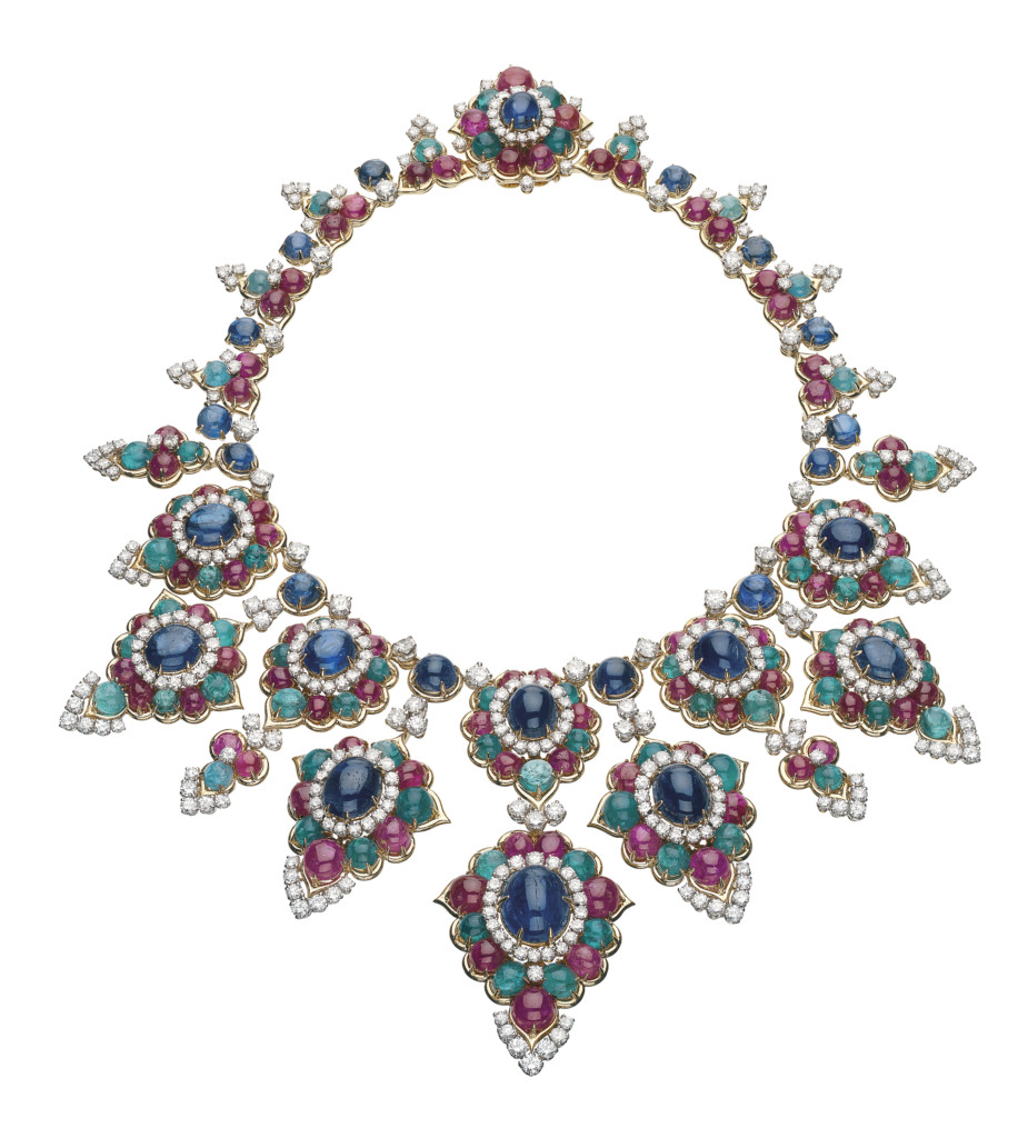 """Necklace in gold with emeralds, rubies, sapphires and diamonds, 1967. The front decorated with 10 large floral clusters set with 25 cabochon sapphires for a total of ca. 67 carats; 71 cabochon emeralds ca. 48 carats (total); 88 cabochon rubies ca. 75 carats (total); 348 brilliant-cut diamonds ca. 22.5 carats (total). The back formed of similarly set foliate motifs. Marks: on the tongue-piece: """"BVLGARI"""" engraved; inside the clasp: """"750""""; """"eagle's head""""; """"SC""""; lozenge with """"R / star / D /""""."""