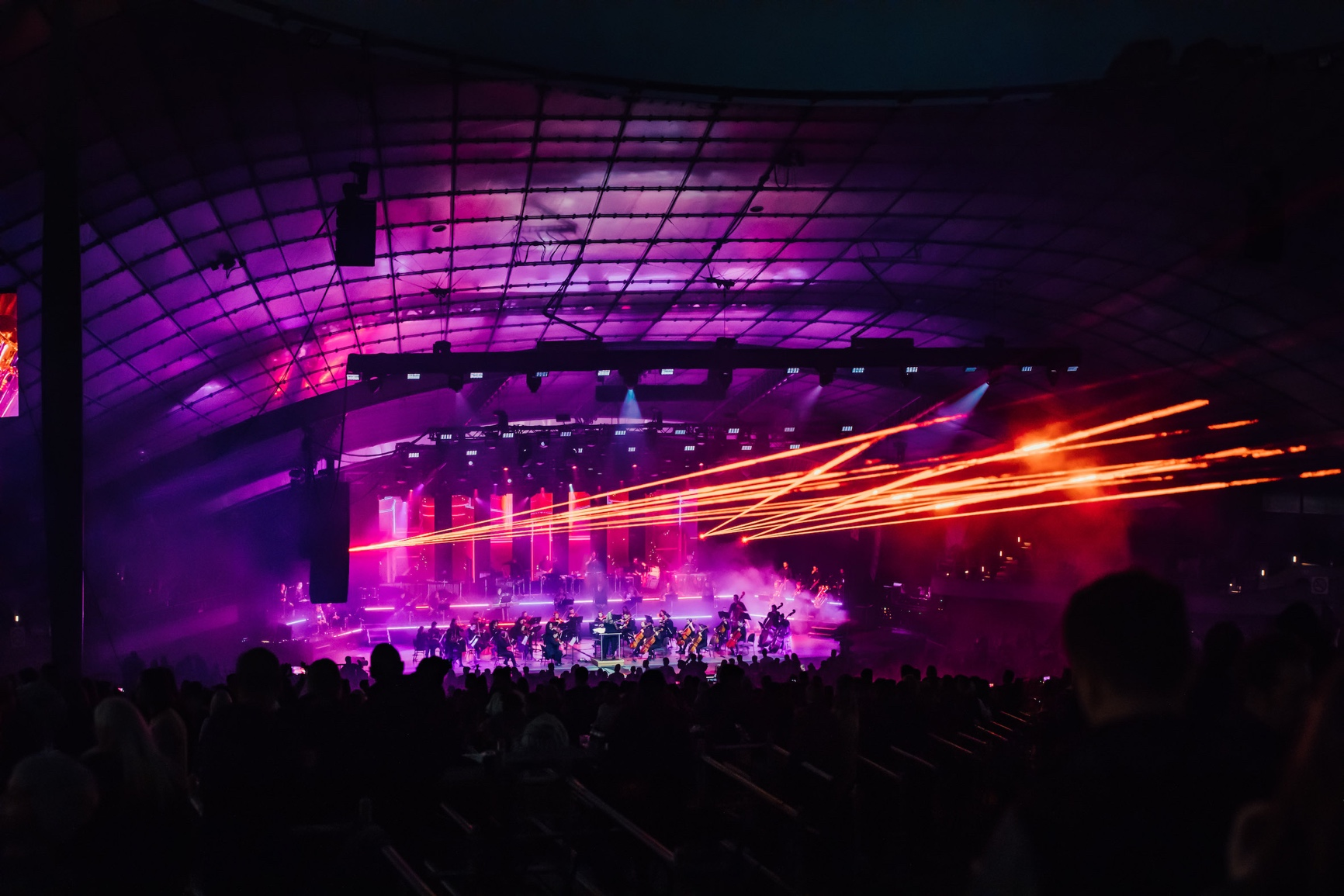 Lasers and big crowds at a music festival