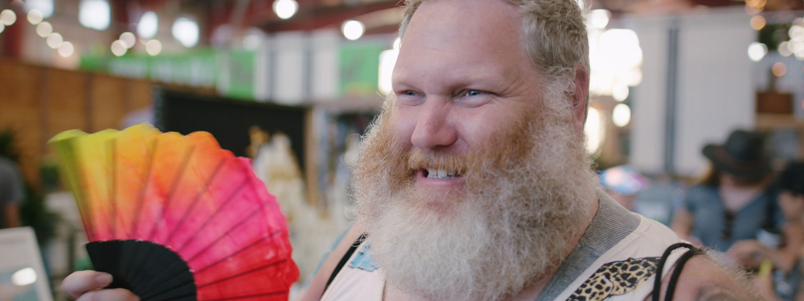Man with rainbow flag and great big beard