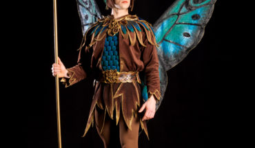 Fantasy Costume of fairy price with butterfyl wings and woodland clothing.